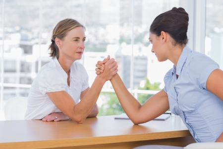 Businesswomen having an arm wrestle in their office Stock Photo - 20586471