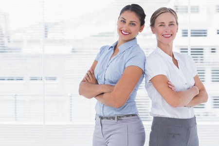 Businesswomen standing back to back and crossing their arms Stock Photo - 20586981