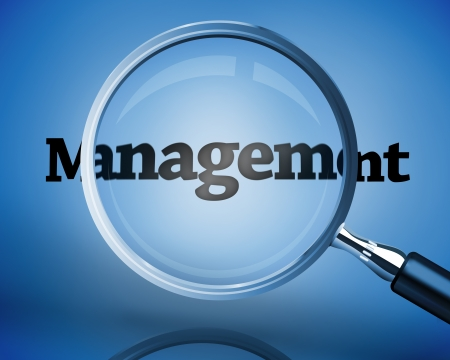 Magnifying glass above the word management on blue background photo