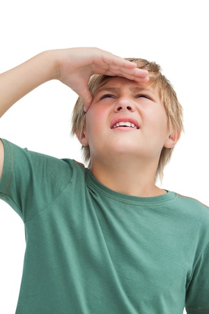 quizzical: Little boy looking up on white background  Stock Photo