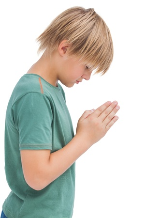 bowed head: Little boy praying with bowed head on white background  Stock Photo