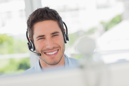 Happy designer having an online communication in his office photo