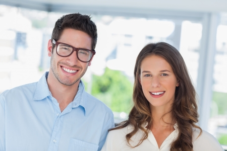 young professionals: Attractive designers standing together in their office