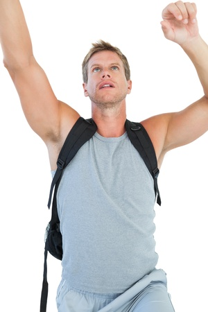 exercices: Man doing his exercices on white background