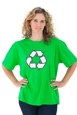 activist: Environmental activist wearing green shirt with recycling symbol on it on white background Stock Photo