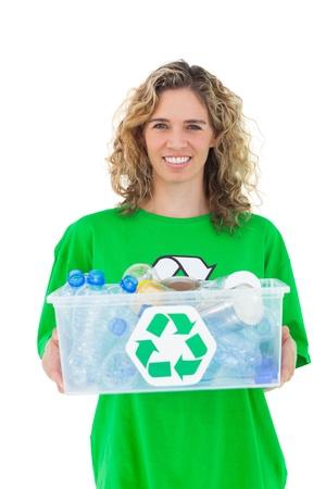 activist: Smiling activist holding recycling box on white background Stock Photo