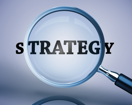 buzz word: Magnifying glass showing strategy word on a reflective surface