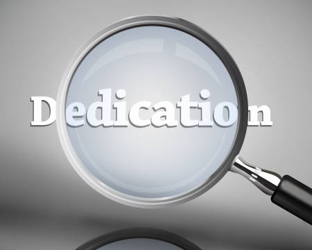 dedication: Magnifying glass showing dedication word in white on grey background