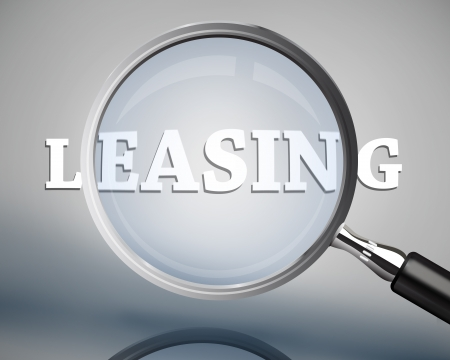 leasing: Magnifying glass showing leasing word in white on grey background Stock Photo