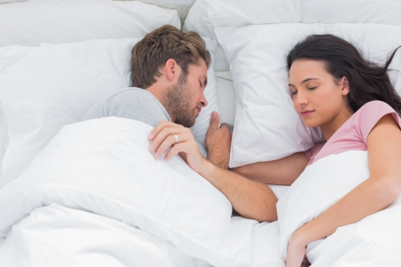 peacefully: Couple sleeping peacefully in bed