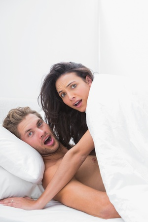 sex on bed: Embarrassed couple caught in the act in bed