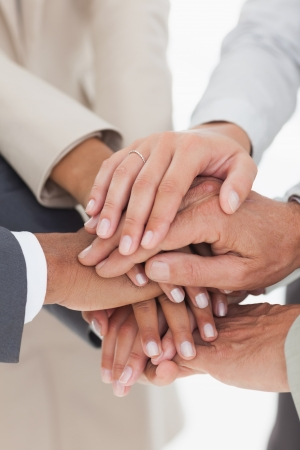 Business teams hands together in unity photo