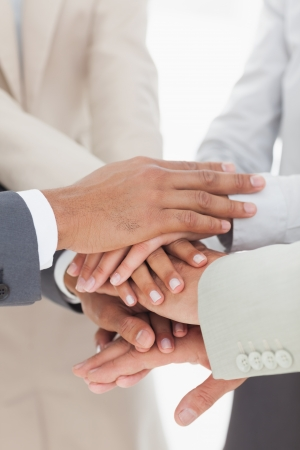 Business colleauges hands together in unity photo
