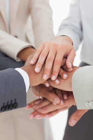 All for one business team with hands together photo