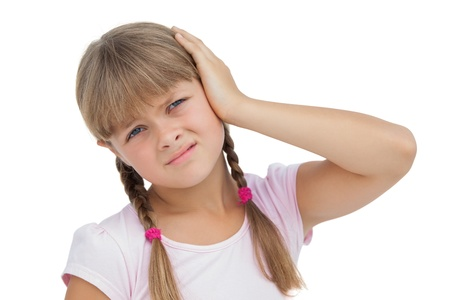 sore eye: Little girl suffering from earache on white background  Stock Photo