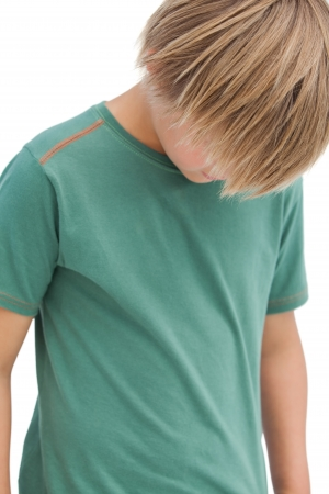 wistfulness: Boy looking down on white background  Stock Photo