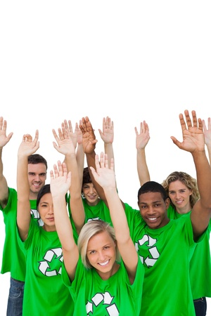 activists: Cheerful group of environmental activists raising arms on white background Stock Photo
