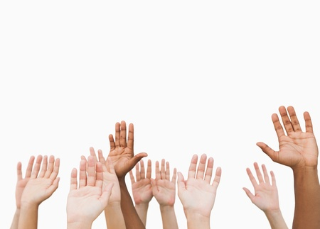 Hands raising in the air on white background photo