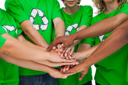activists: Group of environmental activists putting hands together on white background