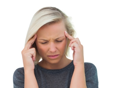 Attractive woman having a headache on white background Stock Photo