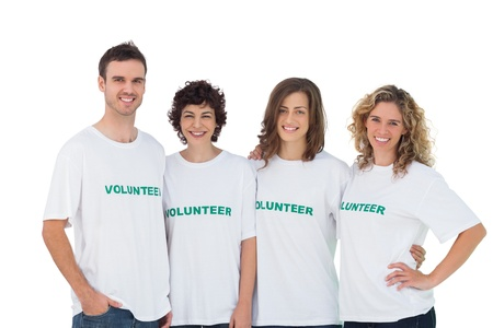 selfless: Cheerful group of volunteers on white background