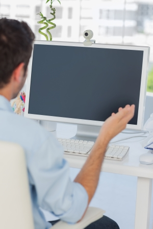 Designer having a video chat in his office on his computer photo