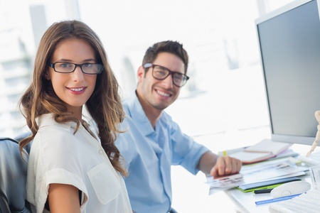 Photo editors posing together in their office Stock Photo - 20637509