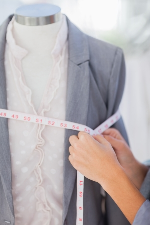 blazer: Designer measuring blazer with measuring tape Stock Photo