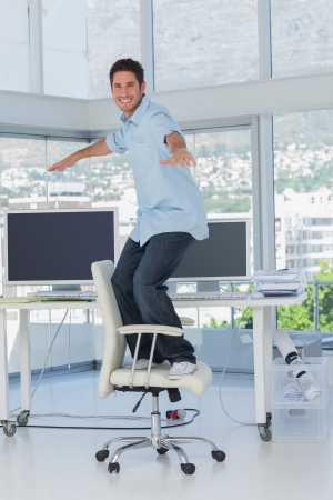 designer chair: Creative designer surfing his swivel chair in his office