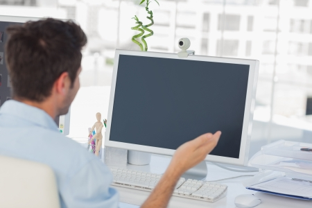 agencies: Designer having a video chat on his computer