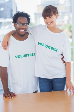Volunteers embracing each other in their office photo