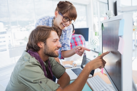 Pair of photo editors working together on the computer Stock Photo - 20639245