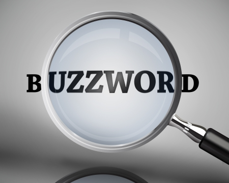 buzzword: Magnifying glass showing buzzword word on grey background