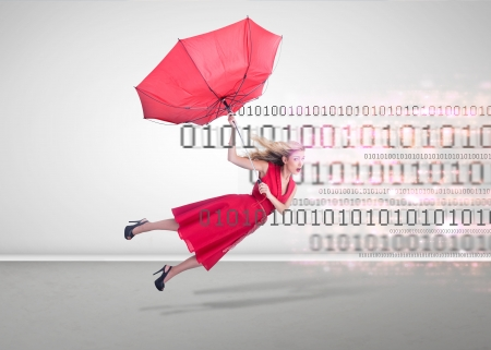 Attractive woman flying in an empty room with binary code in background photo