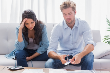 Anxious couple doing their accounts together Stock Photo - 20638786