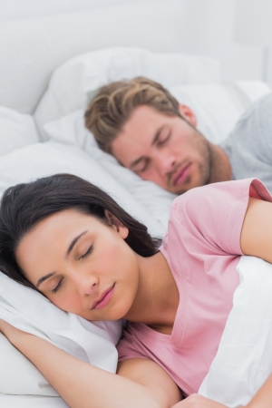 Peaceful beautiful couple sleeping in bed photo