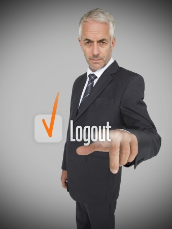 logout: Businessman selecting the word logout next to a ticked box