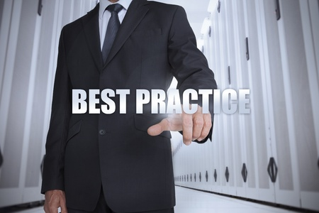 best practice: Businessman selecting the term best practice in a data center Stock Photo