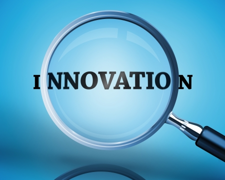 buzz word: Magnifying glass showing innovation word on blue background Stock Photo