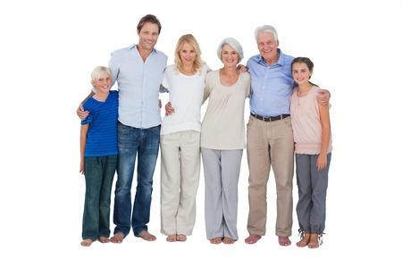 grandfather: Familia feliz de pie sobre un fondo blanco Foto de archivo