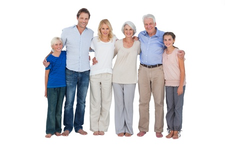 Happy family standing against a white background photo