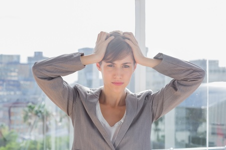 worked: Stressed businesswoman with hands on head