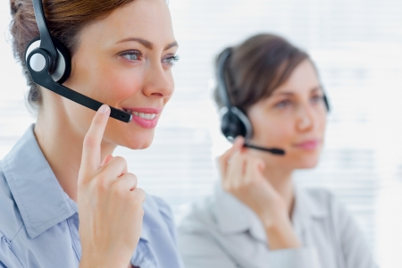 Call centre agents at work and smiling photo