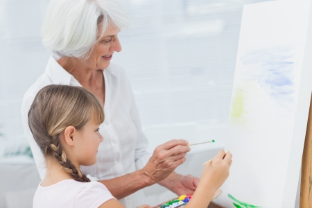 Grandmother and granddaughter painting together at home Stock Photo - 20635915