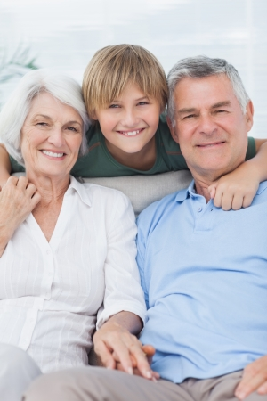 Grandson with his grandparents in the living room Stock Photo - 20629783
