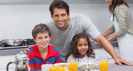 Father and his children smiling at camera in kitchen Stock Photo - 20635102