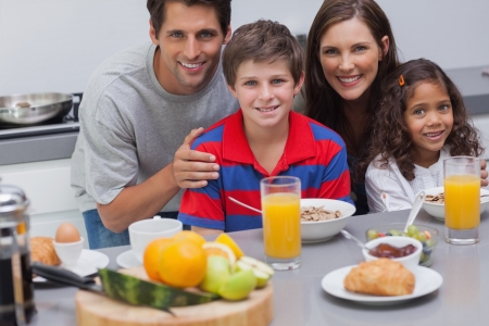 Family during the breakfast in kitchen Stock Photo - 20630774