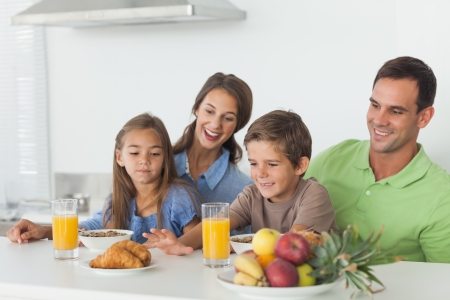 Parents having breakfast with children in the kitchen  Stock Photo - 20637965