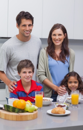 Smiling family at breakfast in kitchen Stock Photo - 20629914
