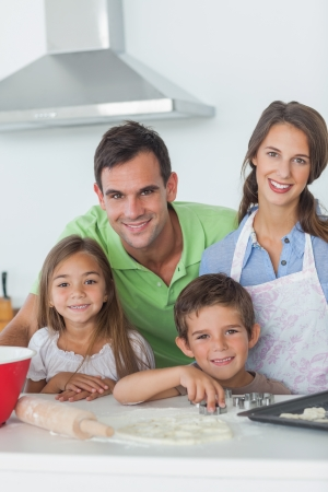 Beautiful family home baking together in the kitchen photo